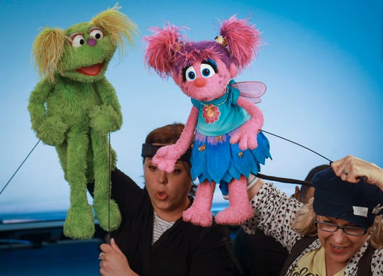"""Puppeteers Haley Jenkins, left, and Leslie Carrara-Rudolph perform with their """"Sesame Street"""" muppets Karli and Abby Cadabby, respectively, for segments about parental addiction."""