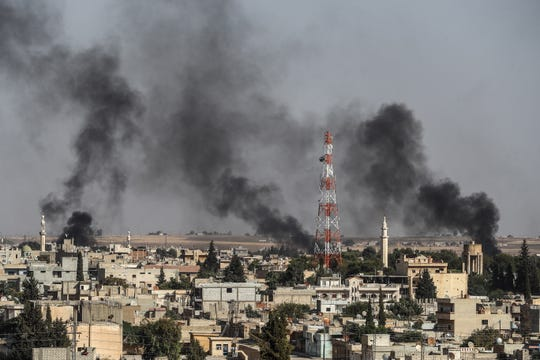Smoke rising from targets inside Syria during bombardment by Turkish forces at Ras al-Ein town, in Ceylanpinar, in Sanliurfa, Turkey on October 10, 2019. Turkey has launched an offensive targeting Kurdish forces in north-eastern Syria, days after the US withdrew troops from the area.
