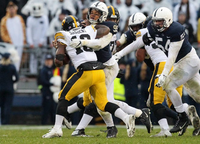 Penn State defensive end Yetur Gross-Matos tackles Iowa running back Mekhi Sargent during their 2018 game at Beaver Stadium.
