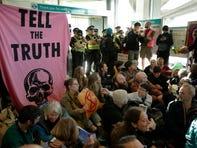 Climate change activist climbs on British Airways plane in London