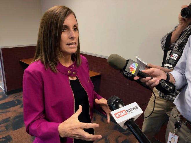 U.S. Sen. Martha McSally, R-Ariz., talks to reporters after an event in Peoria, Ariz., on Monday, Oct. 7, 2019.