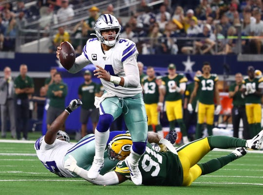 Oct 6, 2019; Arlington, TX, USA; Dallas Cowboys quarterback Dak Prescott (4) scrambles in the fourth quarter against Green Bay Packers linebacker Preston Smith (91) at AT&T Stadium. Mandatory Credit: Matthew Emmons-USA TODAY Sports