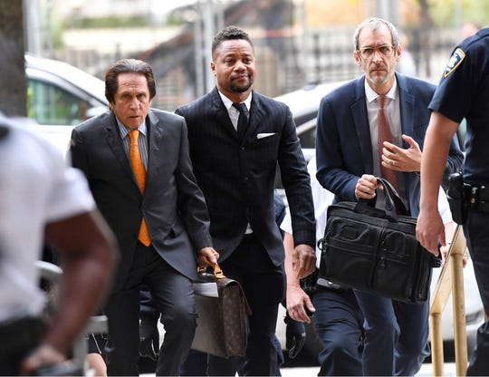 Cuba Gooding Jr., (C) with his lawyers arrive at court for proceeding in his groping case, Oct. 10, 2019, in New York.