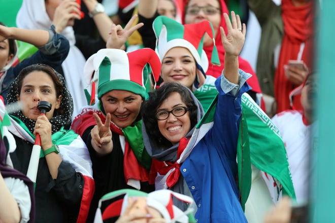 Iranian Women's fans cheer during the FIFA World Cup Qualifier match between Iran and Cambodia at Azadi Stadium on October 10, 2019 in Tehran, Iran.
