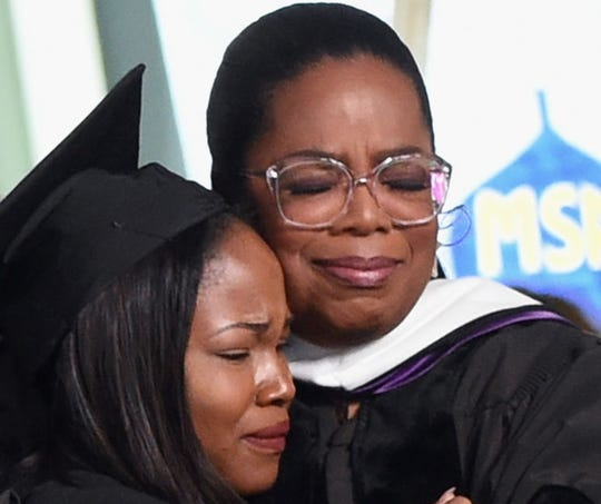 Sithokomele P. Mabaso, (L) an alumni of Oprah Winfrey Leadership Academy for Girls in South Africa, graduates from Agnes Scott College where Oprah Winfrey gave the Commencement Address on May 13, 2017.