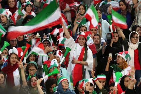Iranian Women's fans react during the FIFA World Cup Qualifier match between Iran and Cambodia at Azadi Stadium on October 10, 2019 in Tehran, Iran.