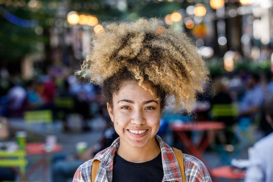 """Catherine Williams, 21, a senior at Georgia State University, says: """"I don't think there's anything unpolished about having dreads, or having a fro... as long as you're taking care of your hair which most people do. I think it's great that we can finally embrace our hair."""""""