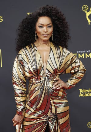 Angela Bassett opens up about being fondled as a young girl.