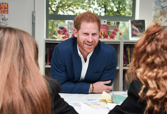 Prince Harry meets students during a visit to Nottingham Academy to mark World Mental Health Day on Oct. 10, 2019 in Nottingham, England.
