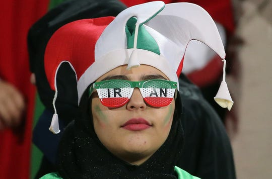 An Iranian woman attends the World Cup Qatar 2022 Group C qualification football match between Iran and Cambodia at the Azadi stadium in the capital Tehran on October 10, 2019.