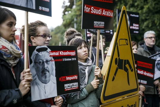 People protest and commemorate the first anniversary of the murder of Saudi Arabian journalist Jamal Khashoggi in an event organized by Reporters Without Borders outside the Saudi Arabian Embassy on October 01, 2019 in Berlin, Germany.