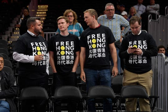 Activists at an NBA exhibition basketball game between the Washington Wizards and the Guangzhou Loong Lions on Oct. 9, 2019.