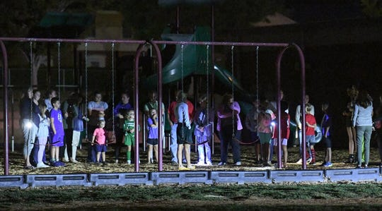 A group of 40 parents and children gathered for  a vigil with prayers and hymns for a fifth-grade student who was injured earlier at the swing playground at Concord Elementary School in Anderson Thursday, October 10, 2019.