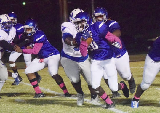 Bolton running back Xxaviea Woods (10) breaks free for a big gain against Deridder High School in District 3-4A play Thursday, Oct. 10, 2019. Deridder won 13-9.