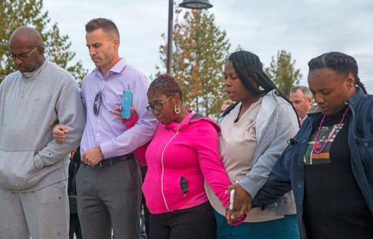 Nikkia Jennings-Fitzpatrick, center, the mother of Jehadje McMillian, a 23-year-old man murdered in Asbury Park in June, appeared with other residents Thursday night at a Ceasefire Vigil at Springwood Park in Asbury Park. Local pastors offered prayers to end the violence.