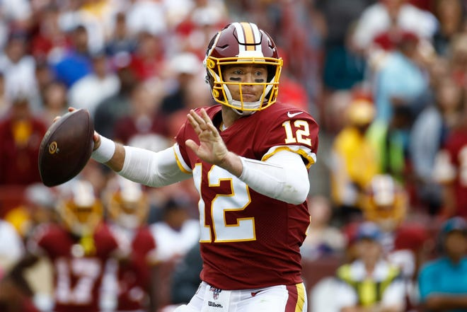 Washington Redskins quarterback Colt McCoy (12) works against the New England Patriots during the second half Sunday, Oct. 6, 2019, in Landover, Md. (AP Photo/Patrick Semansky)