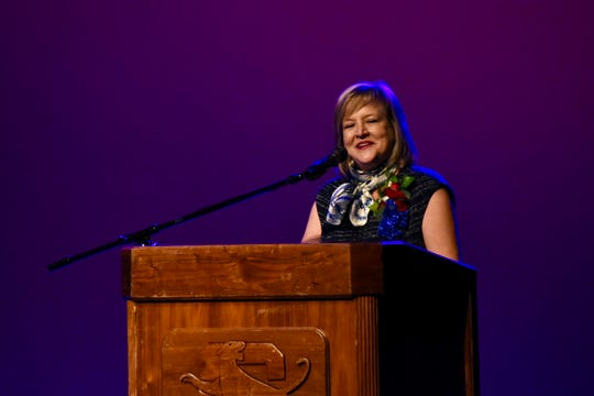 Cathy Ashby, president and CEO of the United Way of Abilene, speaks during a celebration at Cooper High School honoring her as the 85th member of the Cooper High School Hall of Fame on Friday, Oct. 11, 2019. Ashby was expected to be the only inductee but was surprised with a co-inductee, longtime coach and teacher Donna Wise.
