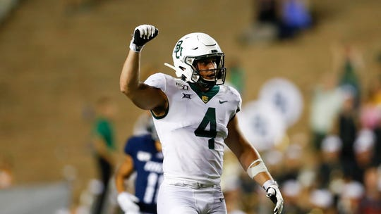 Baylor University linebacker Clay Johnston (4) signals a defensive stop during a game against Rice on Sept. 21 in Houston. (AP Photo/Matt Patterson)