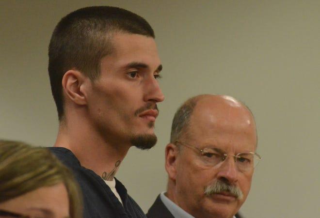 Craig Cole with his attorney, John Sullivan, right.