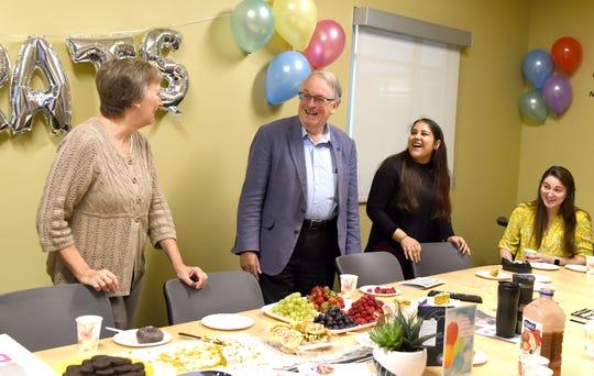 From left: Elaine Schmitz, M. Stanley Whittingham, Anshika Goel and Carrie Kaplan celebrate Whittingham's Nobel Prize in a conference room in Binghamton University's Center of Excellence Building on Friday, Oct. 11, 2019.