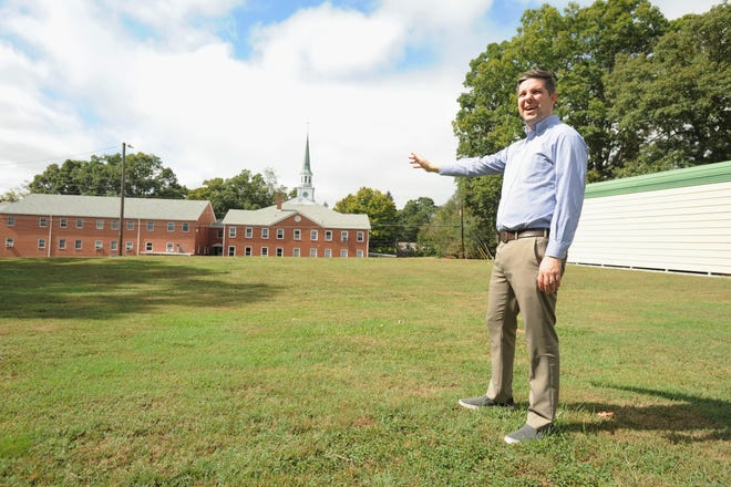 Senior Pastor of First Baptist Church of Black Mountain, Jeremy Shoulta, stands on what could be the future site of Children and Friends Enrichment Center. Members of the church were set to vote on whether or not to approve a lease with the day care, which has been seeking a new location since 2017.