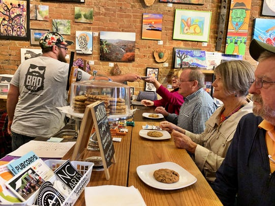 BAD Craft owner Randy Giles passes a butter pecan cookie to guests on Creative Mountain Food Tours' Ultimate Foodie Tour, Oct. 5.