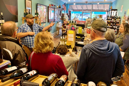 Sam  Shirey, who owns Creative Mountain Food Tours with his wife Alli, welcomes a group to the Merry Wine Market on Oct. 5, for an Ultimate Foodie Tour.