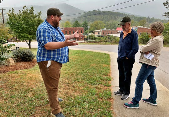 Sam Shirey talks about the history of the Swannanoa Valley while leading the Ultimate Foodie Tour on Oct. 5. The tour is one of several offered through Creative Mountain Food Tours, which Shirey owns with his wife Alli.