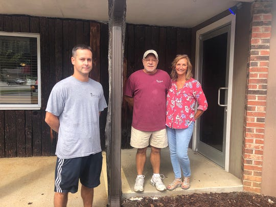 Coach House owners Arthur and Laurie Pappas, and son Evan, are celebrating 25 years of business in Black Mountain this year.