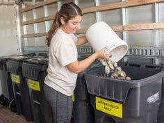 Olivia Escandell, a conservation specialist with Brevard Zoo's Restore Our Shores program, dumps oyster shells discarded by restaurants into a bin. The zoo's Shuck & Share program received a $39,369 Tourism + Lagoon Grant for the current budget year. The shells will be transported to a quarantine site before being used in living shoreline restoration projects.