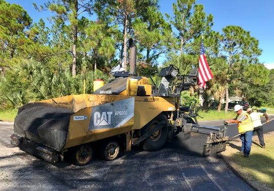 Workers with VA Paving of Cocoa resurface Firethorn Road on Friday in northwest Palm Bay.