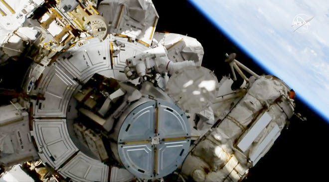 This image provided by NASA shows astronaut Andrew Morgan on a spacewalk outside the International Space Station Oct. 11, 2019.   Morgan and Christina Koch are replacing decade-old batteries in the station's solar power network with new and improved lithium-ion versions. (NASA via AP)