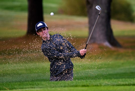 Rice senior Michael Walsh hits out of a greenside bunker on the fourth hole during the 2019 Vermont Division I boys golf championship at The Quechee Club on Thursday, Oct. 10. Walsh was the medalist with an even par 72.