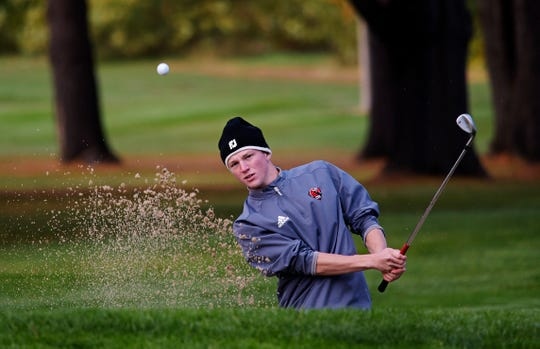 CVU's Nate Godbout hits out of a greenside bunker on the fourth hole during the 2019 Vermont Division I boys golf championship at The Quechee Club on Thursday, Oct. 10. Godbout (2-over 74) led the Redhawks to a first-place team finish.