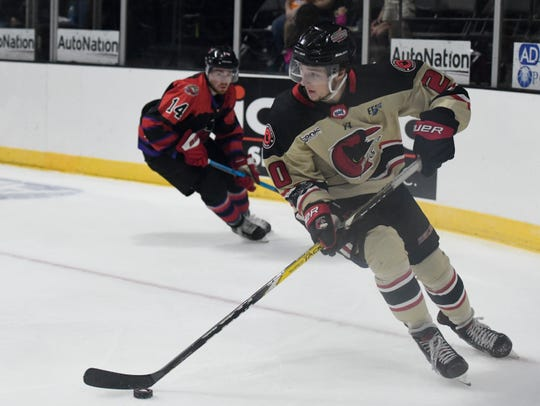 Corpus Christi Icerays' Erik Bargholtz, right, has possession during the game against the Odessa Jackalopes, Thursday, Oct. 10, 2019, at the American Bank Center. The Icerays won, 2-0.