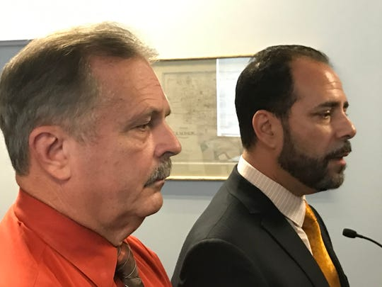 Frank Nucera Jr., left, listens as defense attorney Rocco Cipparone Jr. talks to the media Friday.