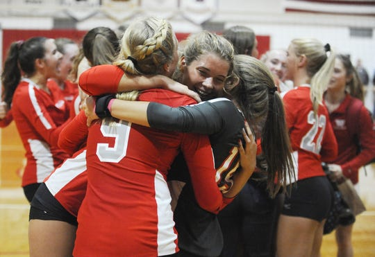 Westfall's Kristin Phillips hugs teammates after clinching an SVC title with a 3-0 win over Zane Trace on Thursday, Oct. 10, 2019 at Westfall High School in Williamsport, Ohio.