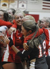 Westfall's Josie Williams hugs her teammates in celebration after clinching an SVC title with a 3-0 win over Zane Trace on Thursday, Oct. 10, 2019 at Westfall High School in Williamsport, Ohio.