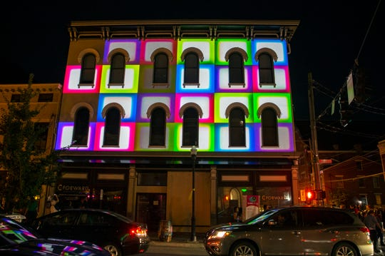 """A building on Madison Avenue in Covington is projected with """"I Spy with my Little Eye"""" by Brave Berlin Blink 2019 Thursday, Oct 10, 2019.This year, Blink spans 30 blocks across Findlay Market and Covington. The installations will be connected by the Roebling Suspension Bridge, which will have a new look immersed in light and sound during the four-day event."""