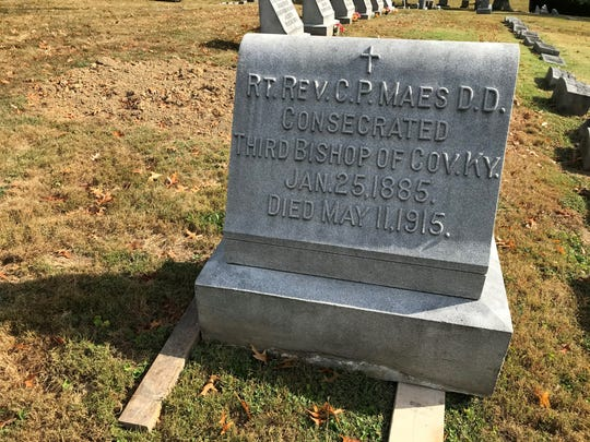 The headstone for the Most Rev. Camillus Paul Maes, third bishop of the Diocese of Covington, rests on boards next to his former grave in St. Mary Cemetery in Fort Mitchell.