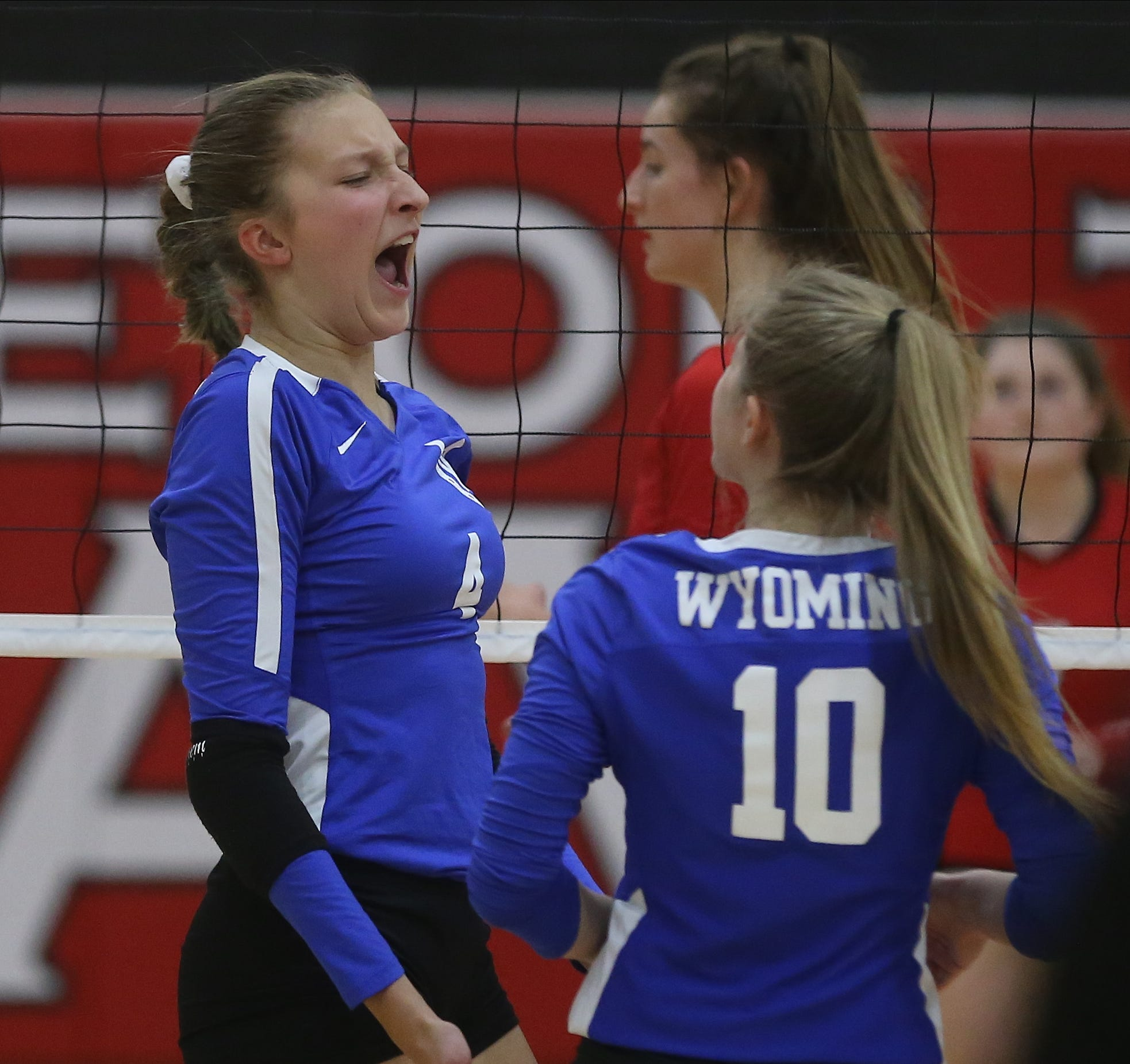 Wyoming player Allie Cordes (4) reacts the Cowboys' Cincinnati Hills League volleyball game against Indian Hill, Thursday, Oct. 10, 2019.