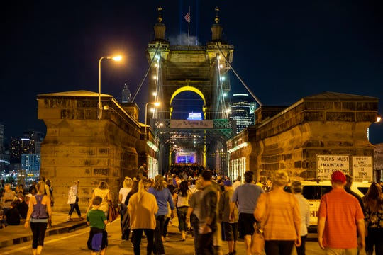 "Lights entitled, ""Rumble"" are projected on the Roebling Suspension Bridge Thursday, October 10, 2019.  This year, Blink spans 30 blocks from Findlay Market in Cincinnati and Covington."