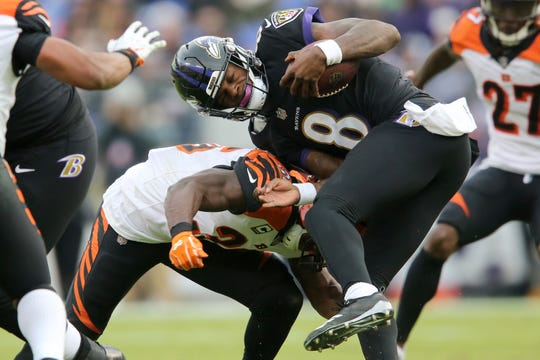 Cincinnati Bengals strong safety Shawn Williams (36) tackles Baltimore Ravens quarterback Lamar Jackson (8) in the third quarter of an NFL football game, Sunday, Nov. 18, 2018, at M&T Bank Stadium in Baltimore.