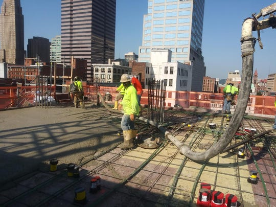 Jostin workers pour concrete for new construction at Eighth and Main streets in Downtown Cincinnati.