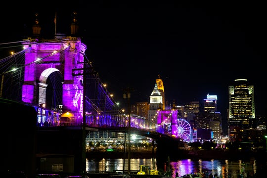 "Lights entitled, ""Rumble"" are projected on the Roebling Suspension Bridge Thursday, October 10, 2019.  This year, Blink spans 30 blocks across Findlay Market and Covington."
