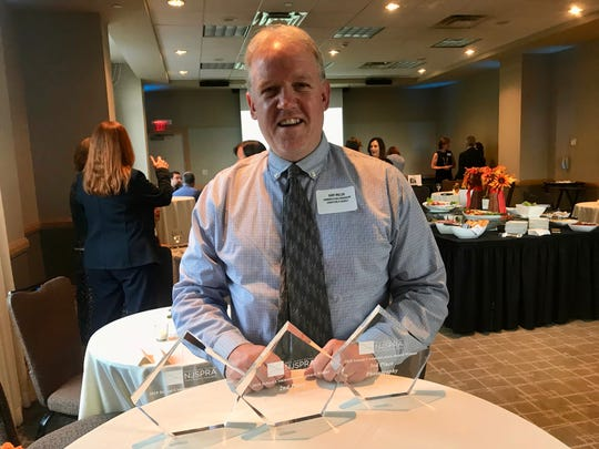 Linden Public Schools Communication Coordinator Gary Miller with three awards he won at the New Jersey School Communication Awards on Thursday, Sept. 26, at the Heldrich Hotel in New Brunswick.