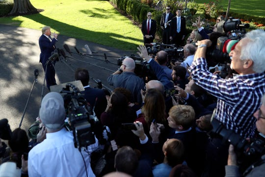 President Donald Trump speaks with reporters on the South Lawn of the White House in Washington on Friday before departing for a campaign rally in Lake Charles, La.