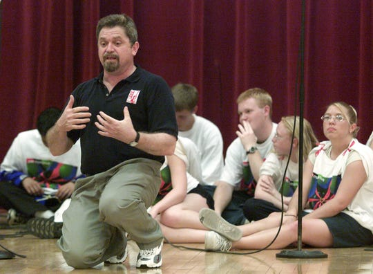 Pat McManus, founder of Rock In Prevention, speaks at East High School in Des Moines back in May 2002.