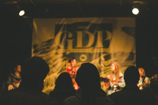 Audience members listen as a band performs during the 2017 Gross Domestic Product music festival in Des Moines. The event, put on by the Des Moines Music Coalition, will return in November, 2019.