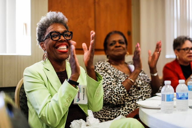 Letitia Ezell claps as she listens during the Warrior Women Against Poverty meeting at Plymouth United Church of Christ in Detroit , Tuesday, Oct. 8, 2019.